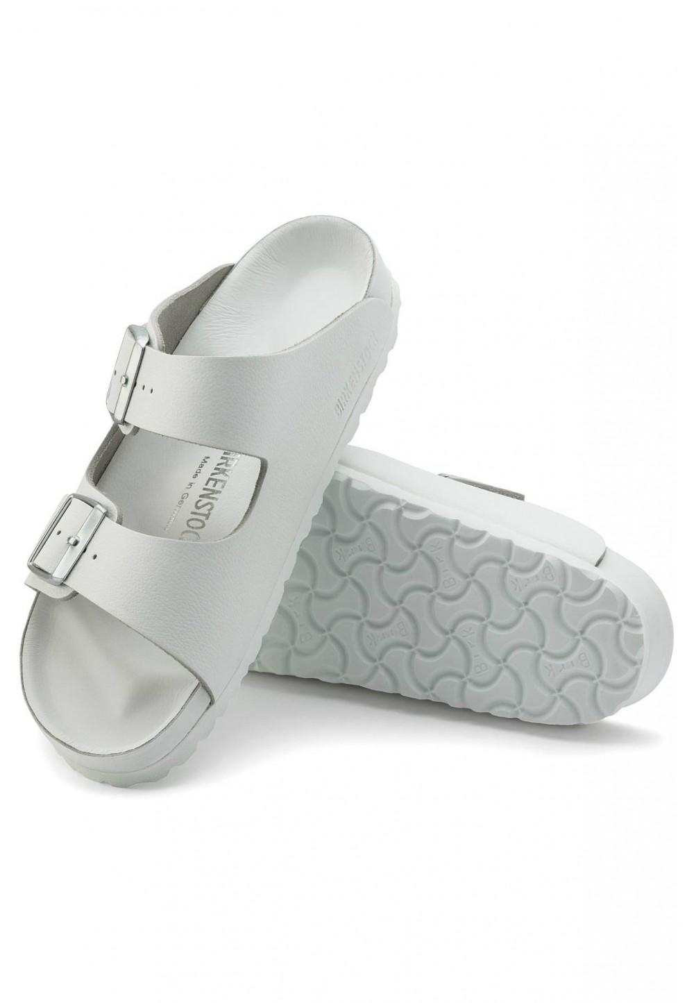 Белые сандалии на две пряжки