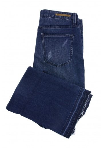 Сині джинси з необробленими краями