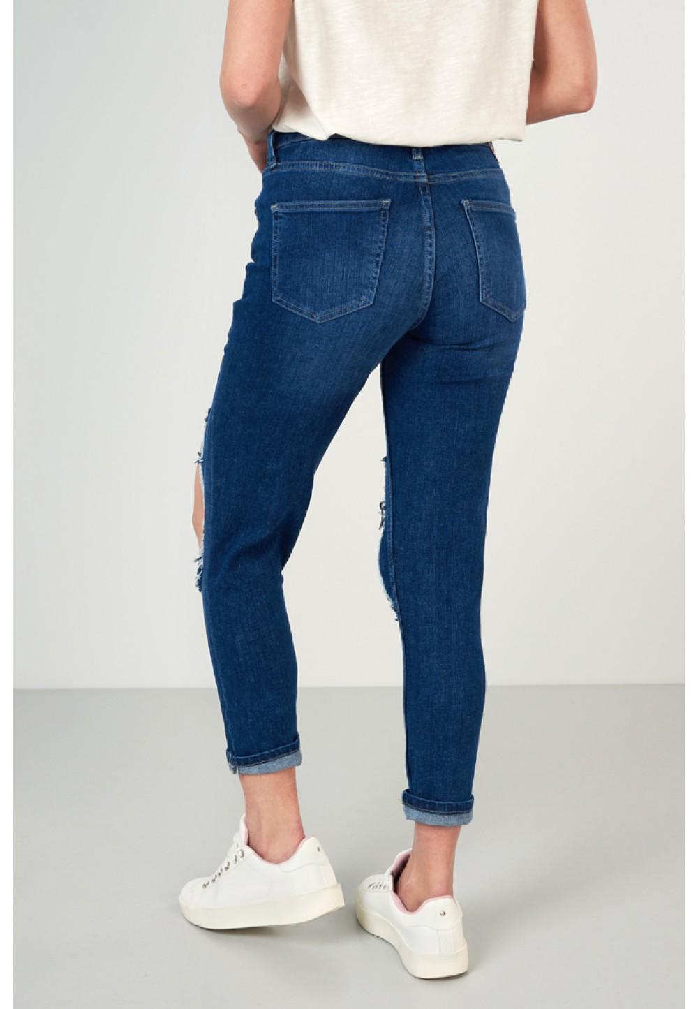 Рвані сині джинси